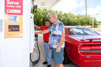 Owner, Larry Fortes, assists customer, Dave Wheaton, at the gas