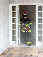 Exiting smoke-filled house